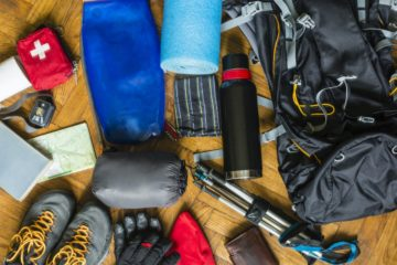 backpacking gear laid out on the floor