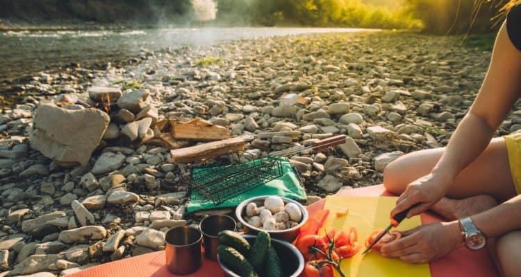 preparing food at a campfire