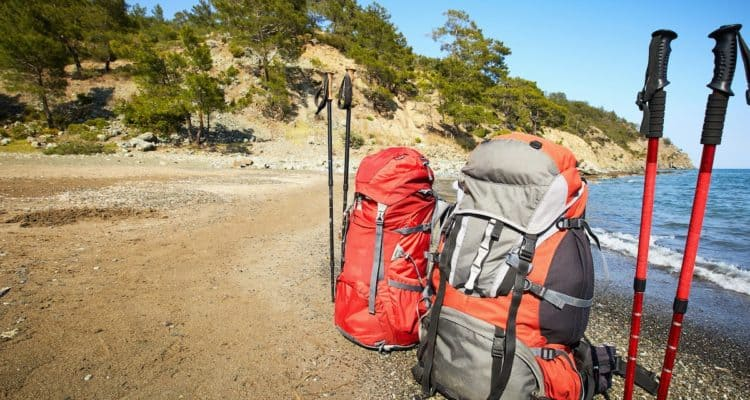 backpacks & hiking poles on the beach