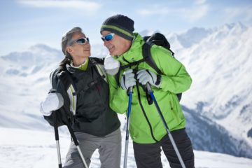 Older couple hiking in the snow