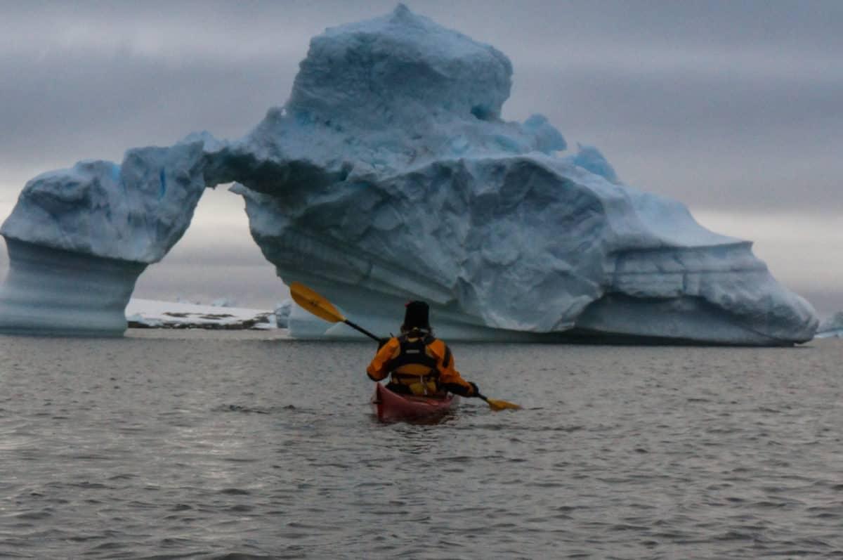 kayaking between icebergs in Antarctica