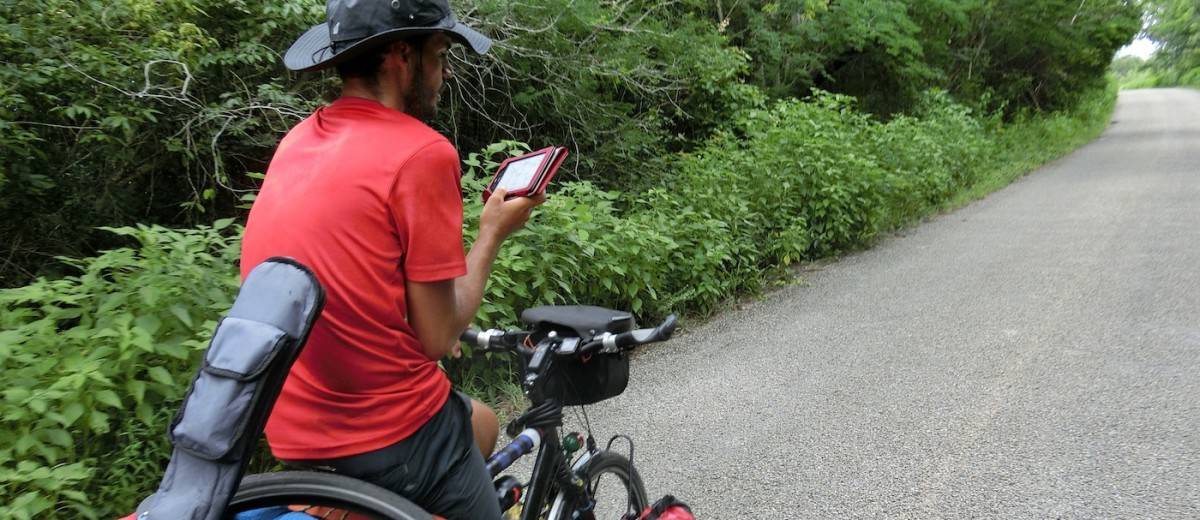 Biking to the Bellybutton of Six Continents Into Thick Air